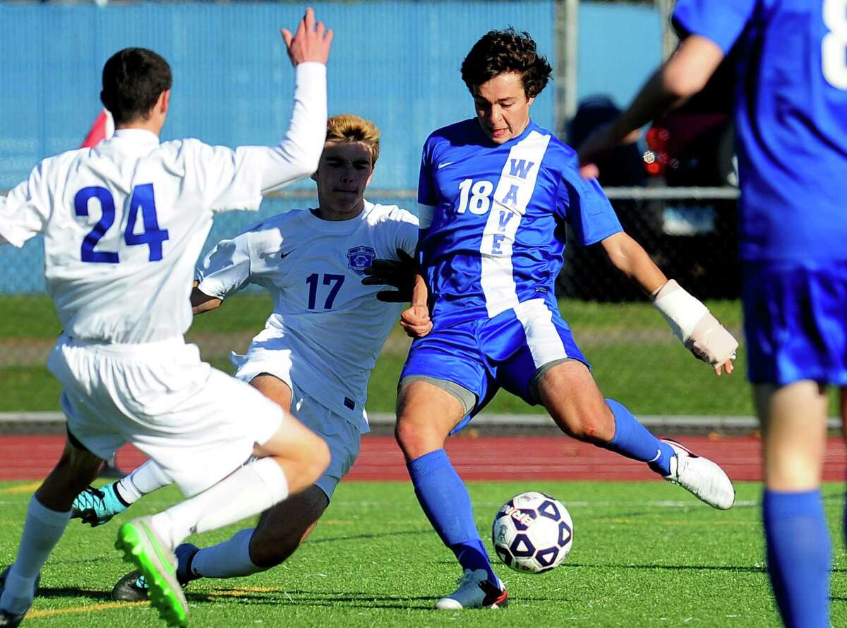 Darien's Pablo Martinez attempts a goal shot during Class LL Boys Soccer Championship action against Glastonbury in West Haven, Conn. on Saturday Nov. 21, 2015.