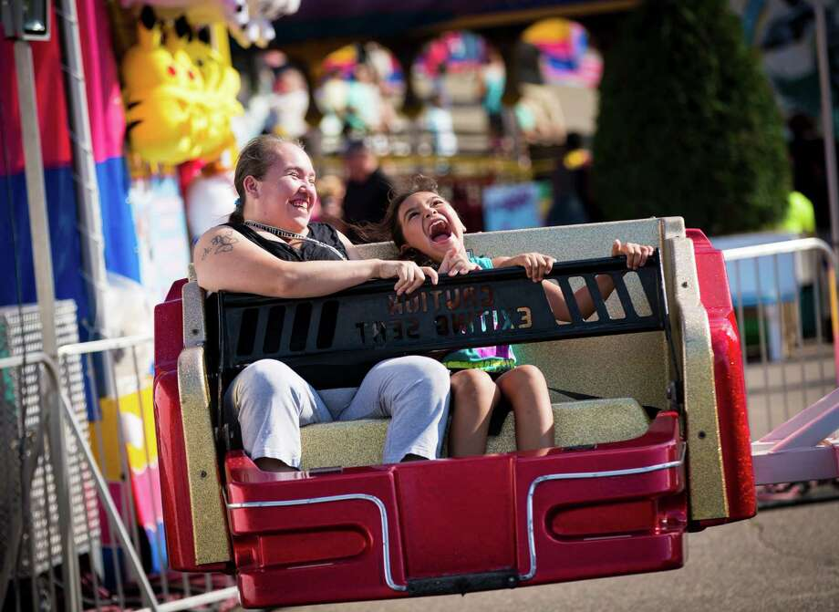 Florence Jack and Airianna Jack, 8, rode the Sizzler at the Minnesota State Fair. Photo: Renee Jones Schneider, MBO / Star Tribune