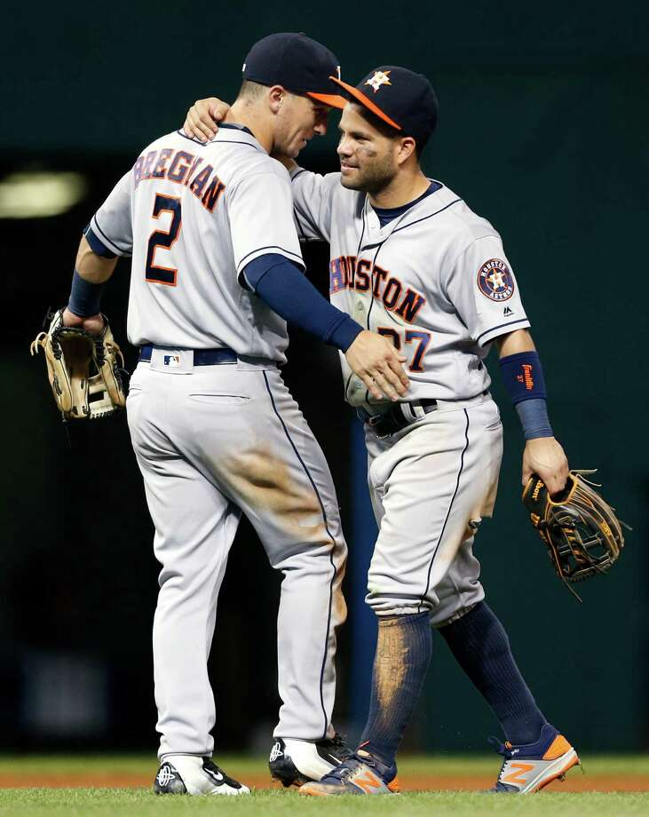 Houston Astros' Alex Bregman (2) and Jose Altuve (27) celebrate the Astros' 6-2 win over the Cleveland Indians in a baseball game Monday, Sept. 5, 2016, in Cleveland. (AP Photo/Ron Schwane) Photo: Ron Schwane, Associated Press / AP 2016