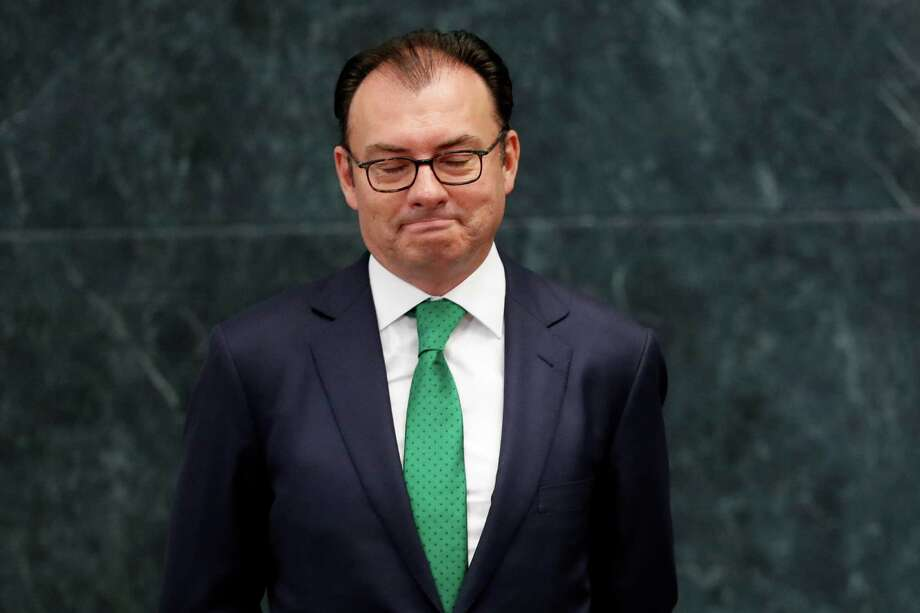 Mexico's Finance Secretary Luis Videgaray looks down as President Enrique Pena Nieto announces Videgaray's resignation at Los Pinos presidential residence in Mexico City, Wednesday, Sept. 7, 2016. One of Pena Nieto's closest advisers and confidants, Videgaray handed in his resignation, in a move observers said was linked to the unpopular decision to invite Republican presidential nominee Donald Trump to visit Mexico. (AP Photo/Dario Lopez-Mills) Photo: Dario Lopez-Mills, STF / Copyright 2016 The Associated Press. All rights reserved.
