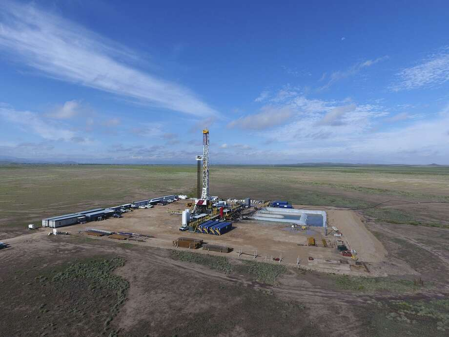 Apache operations in West Texas. Houston's Kinder Morgan said Thursday it's ready to move forward with its $1.7 billion gas pipeline from West Texas to the Corpus Christi area after signing on Apache Corp. as a major customer. Photo: Courtesy /Courtesy
