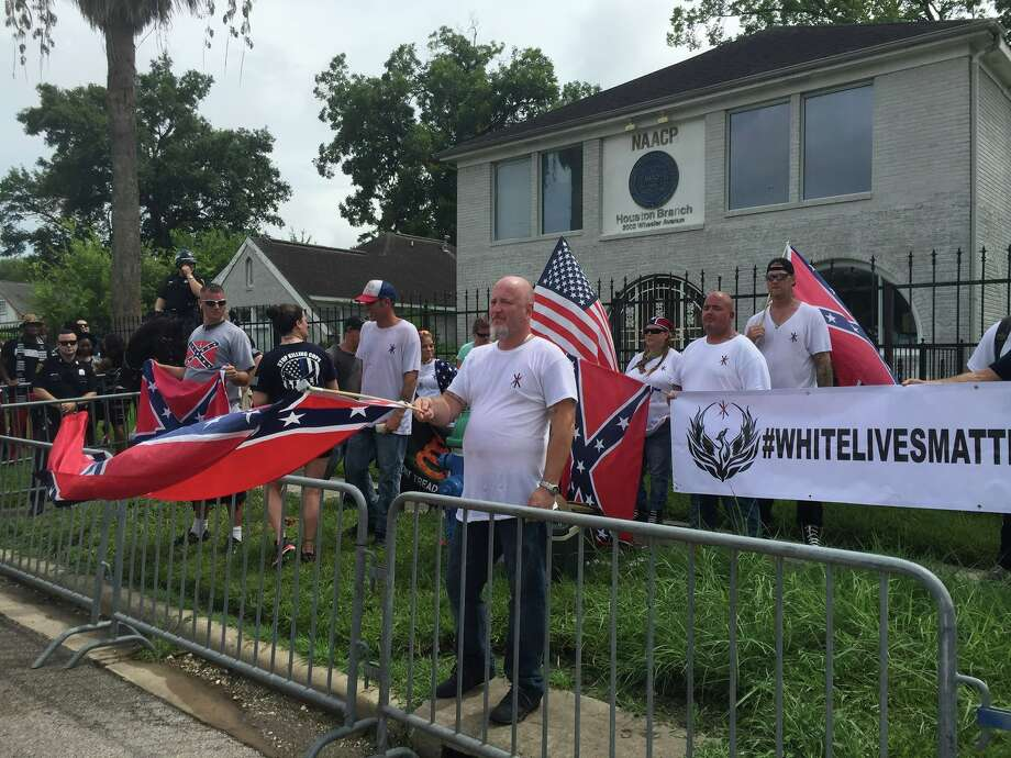 Protesters in front of Houston's NAACP office in Third Ward on Sunday, Aug. 21, 2016. (Darla Guillen / Houston Chronicle) Photo: Darla Guillen/Houston Chronicle