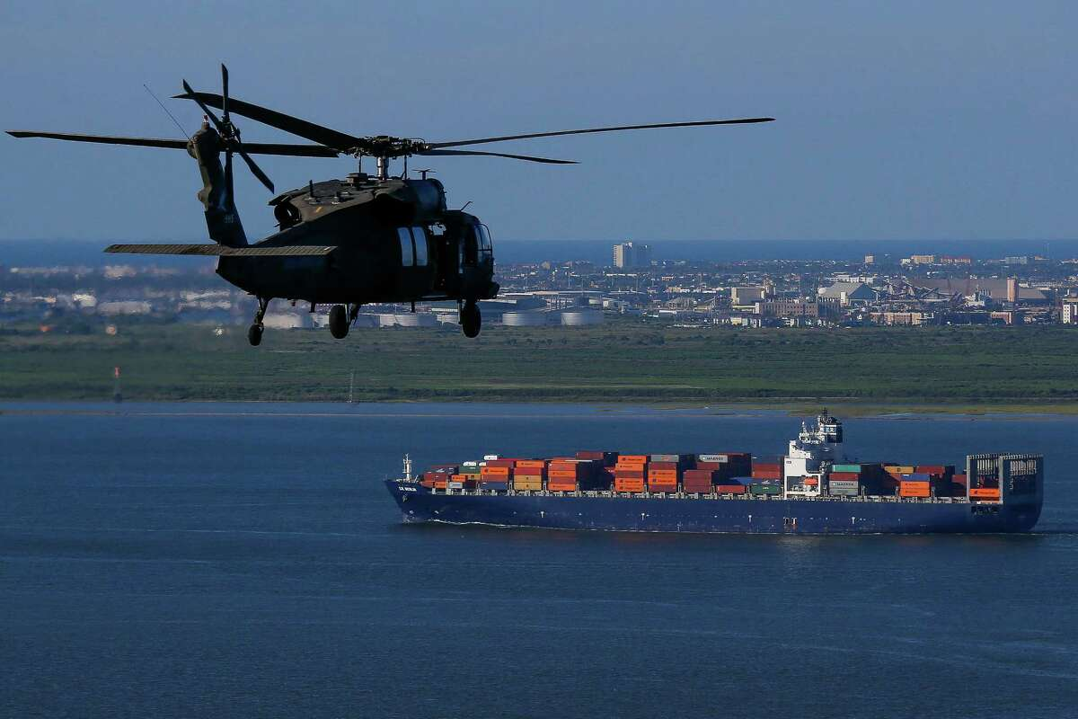 """An Army Black Hawk helicopter, carrying U.S. Army Corps of Engineers officials, flies over the ship channel Wednesday, Sept. 7, 2016. A dike, called the """"Ike Dike,"""" is being proposed to protect Galveston, Bolivar and the Galveston Bay area from storm surges."""