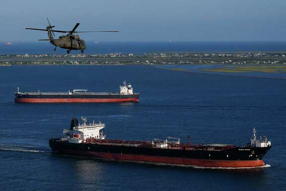 "An Army Black Hawk helicopter, carrying U.S. Army Corps of Engineers officials, flies over the ship channel Wednesday, September 7, 2016. A dike, called the ""Ike Dike,"" is being proposed to protect Galveston, Bolivar and the Galveston Bay area from storm surges."