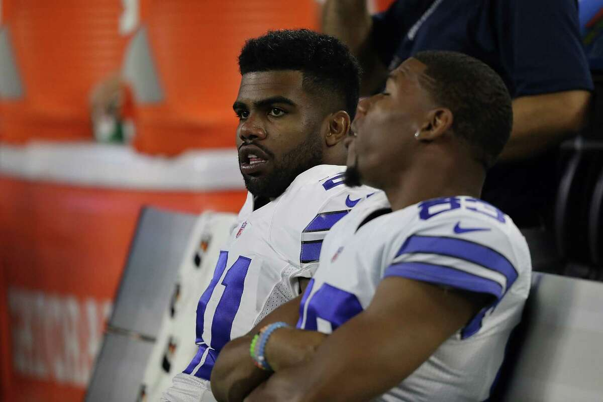 Ezekiel Elliott (left) of the Dallas Cowboys talks to Terrance Williams on the sidelines during a preseason game against the Houston Texans at AT&T Stadium on Sept. 1, 2016 in Arlington.