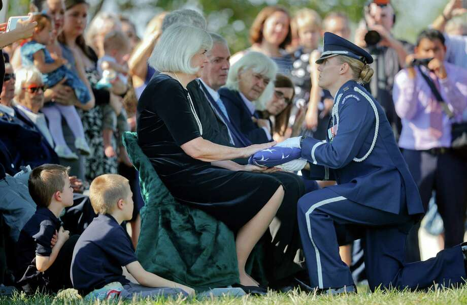 Air Force Capt. Jennifer Lee, right, presents an American flag to Terry Harmon, daughter of World War II pilot Elaine Danforth Harmon, during burial services on Wednesday at Arlington National Cemetery.  Photo: Pablo Martinez Monsivais, STF / Copyright 2016 The Associated Press. All rights reserved.