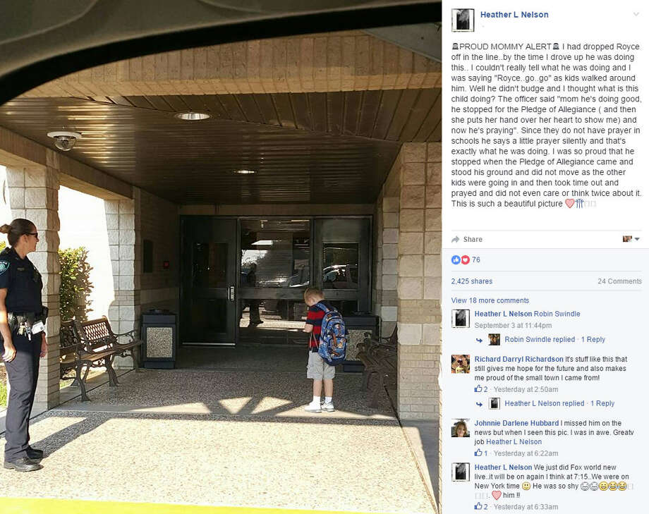 A little boy was late for school on Sept. 1, 2016, and as he was rushing into the building, he stopped abruptly for the Pledge of Allegiance. His mom got a snap of the photo and it's since gone viral. Photo: Heather Nelson