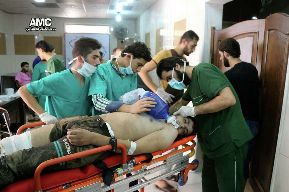 Medical workers treat a man with breathing difficulties - possibly the result of a suspected chlorine attack -  inside a hospital in Aleppo, Syria on Tuesday. Two people died in that attack.  Photo: Uncredited, UGC / Aleppo Media Center