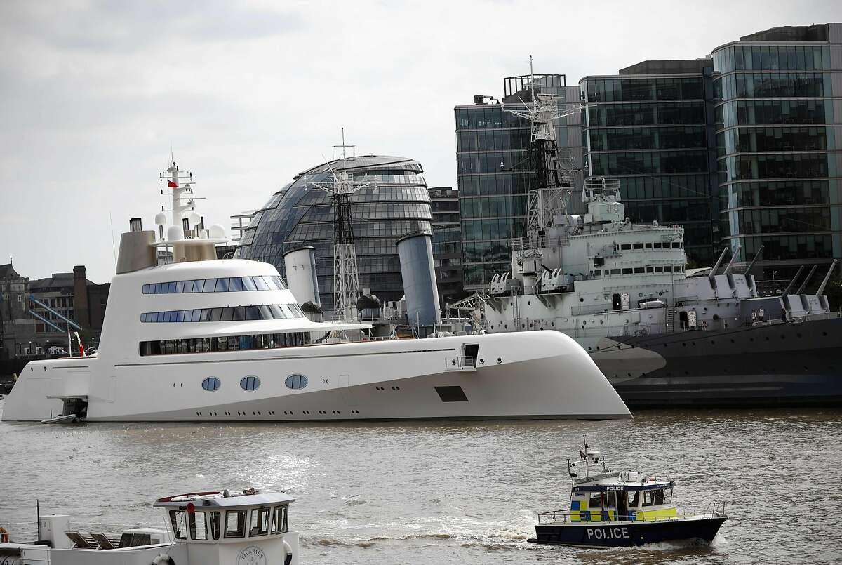 A superyacht, Motor Yacht A, owned by Russian billionaire Andrey Melnichenko is moored against HMS Belfast on the river Thames in London September 7, 2016. Designed by French designer Philippe Starck the luxury superyacht boasts three pools, specially designed fixtures and fittings, a helipad and a disco.