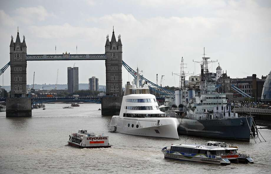 A superyacht, Motor Yacht A, owned by Russian billionaire Andrey Melnichenko is moored against HMS Belfast on the river Thames in London September 7, 2016.  Designed by French designer Philippe Starck the luxury superyacht boasts three pools, specially designed fixtures and fittings, a helipad and a disco. Photo: ADRIAN DENNIS, AFP/Getty Images