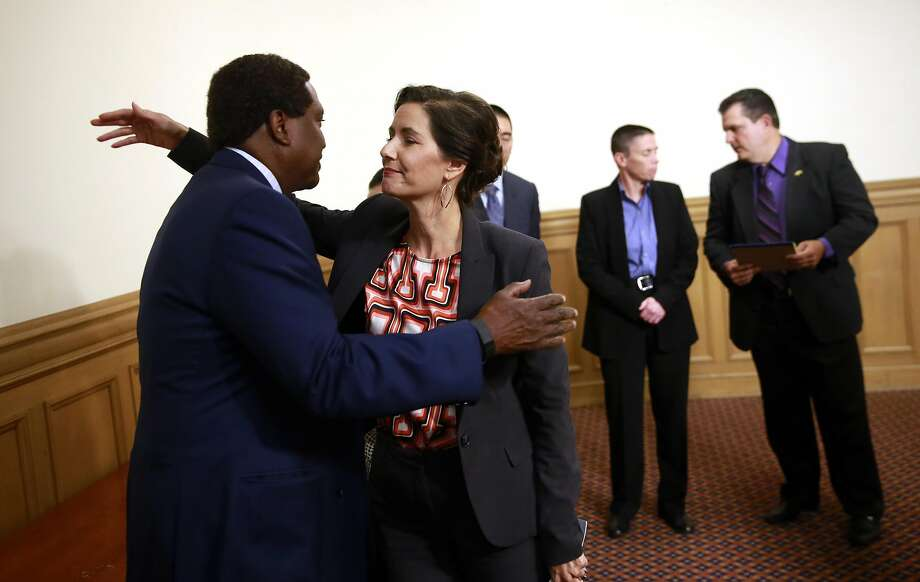 Oakland Mayor Libby Schaaf greets Oakland attorney John Burris after her press conference to discuss the disciplinary actions against the Oakland police officers involved in the Celeste Guap sex scandal, at city hall  in Oakland, Calif., on Wed. Sept. 7, 2016. Photo: Michael Macor, The Chronicle