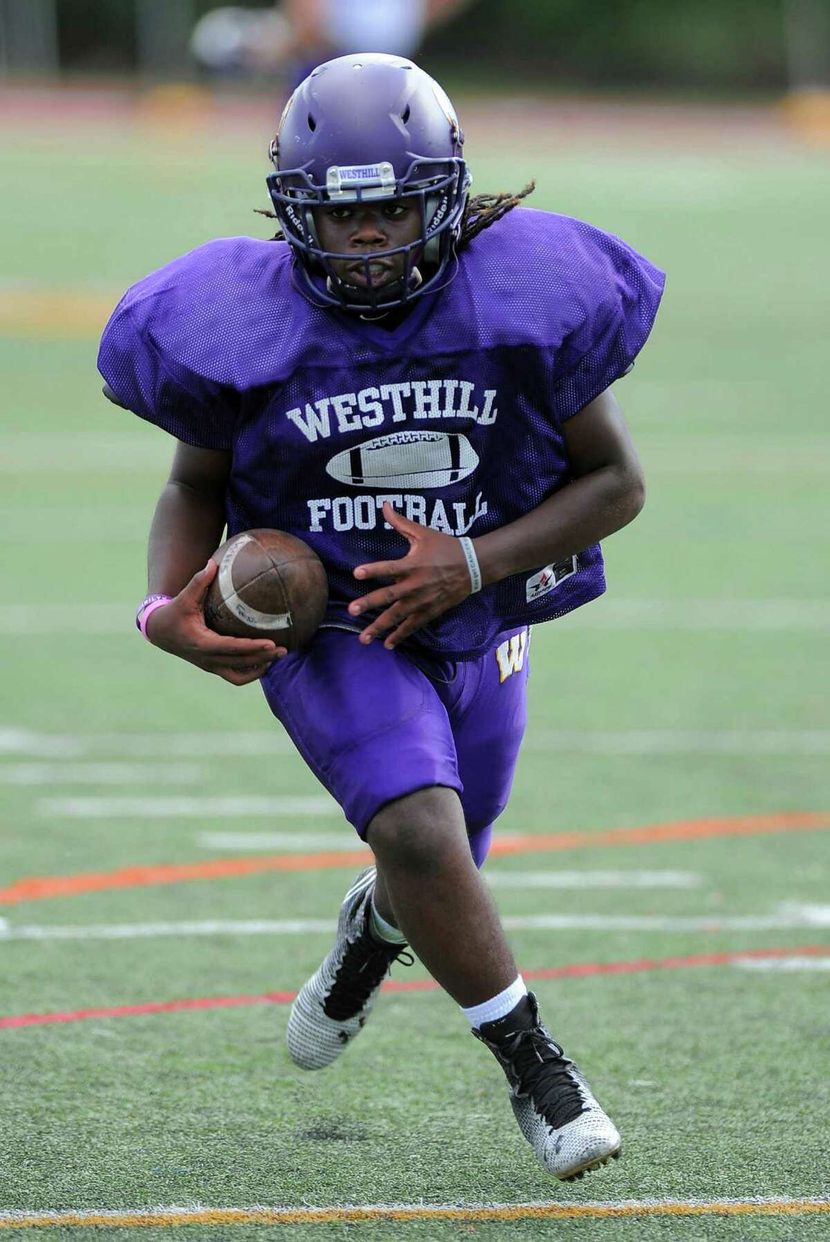 Westhill R.J. Jackson runs the ball back on a punt return drill during a team practice at the school in Stamford on Wednesday, Sept 7, 2016.