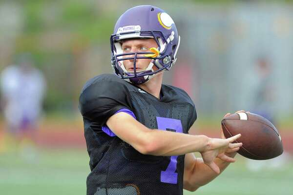Westhill quarterback Blake Newcomber takes warm up throws at a team practice at the school in Stamford on Wednesday, Sept 7, 2016.