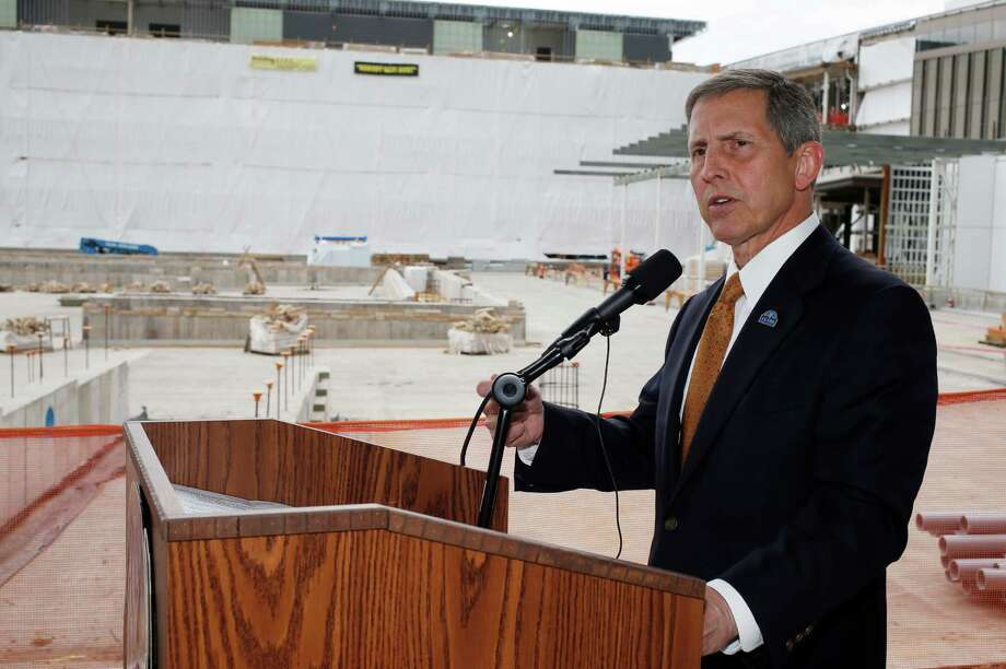 FILE - In this July 1, 2015 file photo, Veterans Affairs Deputy Secretary Sloan Gibson speaks near construction for the VA hospital during a news conference, in Aurora, Colo. A House committee will vote on whether to issue a subpoena to the Veterans Affairs Department demanding the agency turn over documents that could explain how the cost of a Denver-area VA hospital ballooned to almost $1.7 billion, nearly triple earlier estimates. The Veterans Affairs Committee scheduled a vote for Wednesday, Sept. 7, 2016, on a subpoena for documents gathered by a VA internal inquiry called an administrative investigation board. (AP Photo/David Zalubowski, File) Photo: David Zalubowski, STF / Copyright 2016 The Associated Press. All rights reserved.