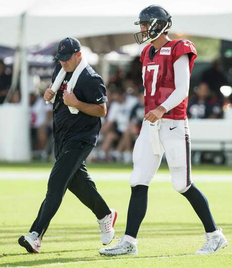 "Bill O'Brien, left, has clear expectations for Brock Osweiler's first start: ""I just want him to do a good job of making good decisions for the football team."" Photo: Brett Coomer, Staff / © 2016 Houston Chronicle"