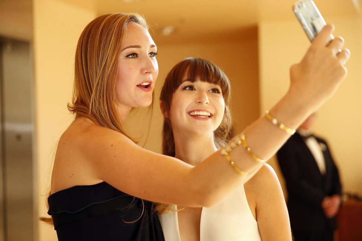 Caroline Joost and Rose Fisher take a selfie before San Francisco Symphony Opening Night Gala in San Francisco, Calif., on Wednesday, September 7, 2016.