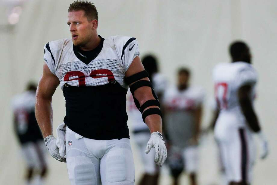 After back surgery earlier this summer to repair a herniated disc, Houston Texans defensive end J.J. Watt (99), left, returns to practice at the Houston Methodist Training Center Monday, September 5, 2016 in Houston. ( Michael Ciaglo / Houston Chronicle ) Photo: Michael Ciaglo, Staff / © 2016  Houston Chronicle