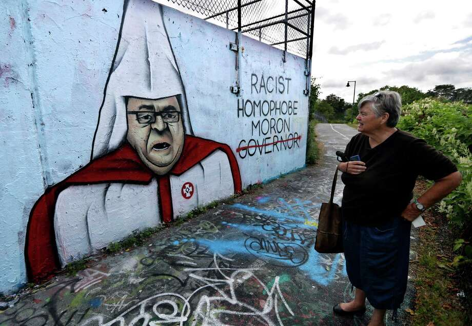 Graffiti painted on a public art space depicts Gov. Paul LePage in a white hood and robe with a red Ku Klux Klan insignia on Tuesday in Portland, Maine. Photo: Robert F. Bukaty, STF / Copyright 2016 The Associated Press. All rights reserved.
