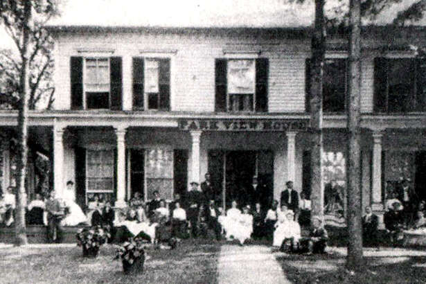 "Above is the Park View House on Bridge Street in New Milford, circa 1900, facing the Village Green. Today it is known as the Lillis Funeral Home. According to Frances L. Smith's ""Images of America - New Milford,"" the building was built in 1823 by Ithnar and Bessie Canfield for their son, Royal S. Canfield and his wife. In 1871, Merritt Beeach bought the house and leased it for 40 years as a boardinghouse known as the Wheaton Hosue and then Park View. In 1910, C.M. Beach remodeled it as a Greek Revival-style residence."