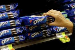 Mondelez International says it plans to sell Oreo-branded chocolate bars made with the company's Milka chocolate. The new bars will be made in Europe.