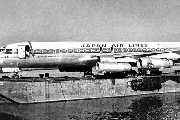 The Japan Air Lines flight that landed in the Bay on Nov. 22, 1968, is lifted into a barge later the same day.The Japan Air Lines flight that landed in the Bay on Nov. 22, 1968, is lifted into a barge later the same day.