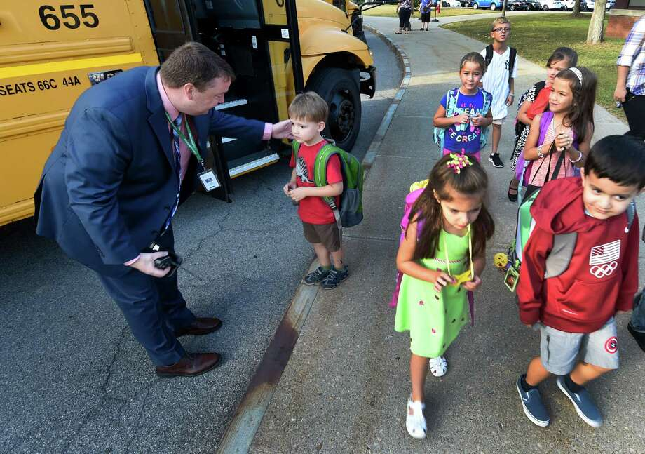 Principal Andy Hill gives some direction and comfort to a kindergartener on his first day of school at Arongen Elementary School Wednesday Sept. 7, 2016 Clifton Park, N.Y.    (Skip Dickstein/Times Union) Photo: SKIP DICKSTEIN / 20037892A