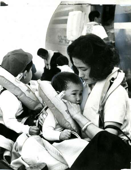 A mother comforts her child after a Japan Air Lines flight landed in the Bay. Photo is dated Nov. 22, 1968. Taken by Peter Covert, a passenger on the plane. Photo: Peter Covert
