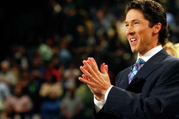 Joel Osteen preaches during a worship service he leads with his wife, Victoria, Sunday, at Lakewood Church, the congregation he took over 8 years ago after the death of his father, John Osteen, founder of the institution.   Sunday, Sept. 30, 2007, in Houston. (Steve Ueckert / Chronicle)