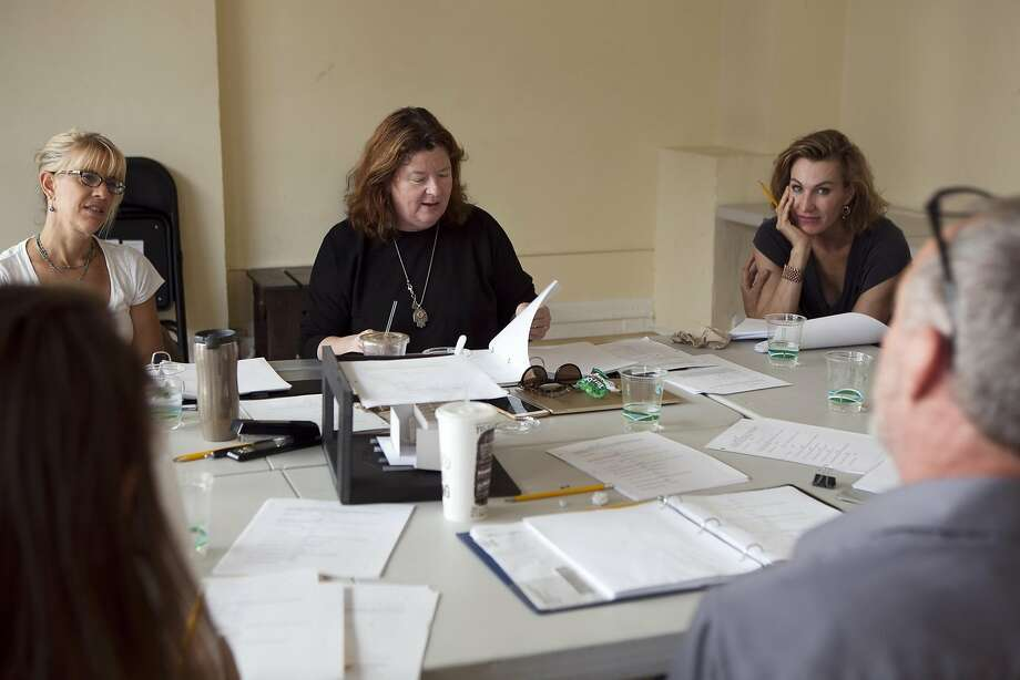 "Playwright Theresa Rebeck reviews the script during a table reading of her new play, ""Seared,"" in San Francisco. Photo: Gabriella Angotti-Jones, The Chronicle"