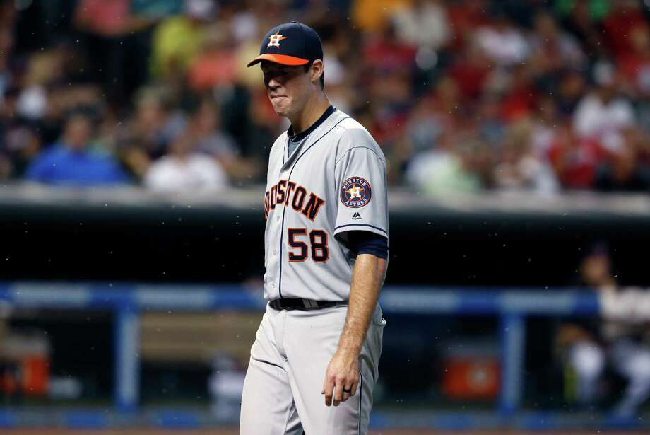 Houston Astros starting pitcher Doug Fister walks off the field through a swarm of bugs after being pulled during the fifth inning of a baseball game against the Cleveland Indians on Wednesday, Sept. 7, 2016, in Cleveland. (AP Photo/Ron Schwane) Photo: Ron Schwane, FRE / AP 2016