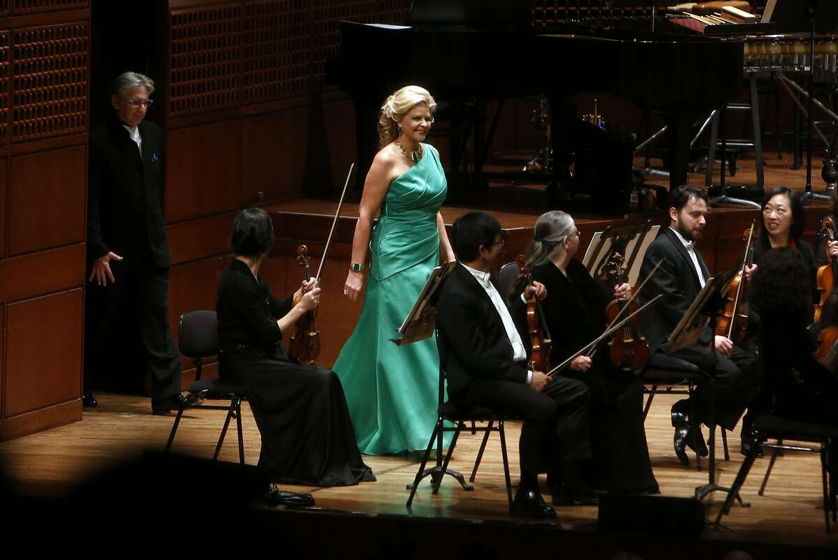 Mezzo-soprano Susan Graham and Conductor Michael Tilson Thomas walk onto the stage during San Francisco Symphony Opening Night Gala in San Francisco, Calif., on Wednesday, September 7, 2016.
