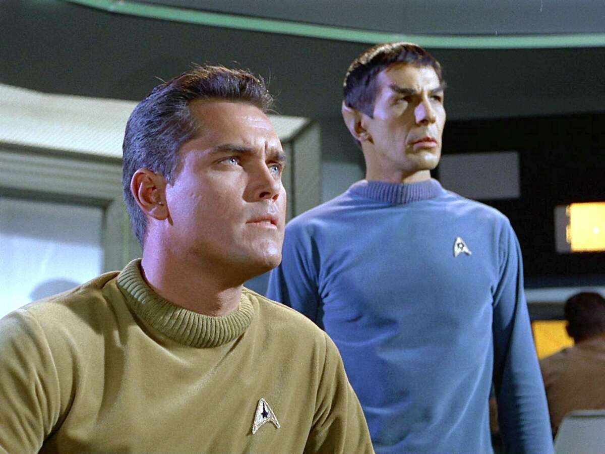 """Jeffrey Hunter as Captain Christopher Pike and Leonard Nimoy as Commander Spock (Mr. Spock) on the bridge of the USS Enterprise in the STAR TREK: The Original Series episode, """"The Cage."""" This is the pilot episode completed early 1965, but not broadcast until October 4, 1988."""