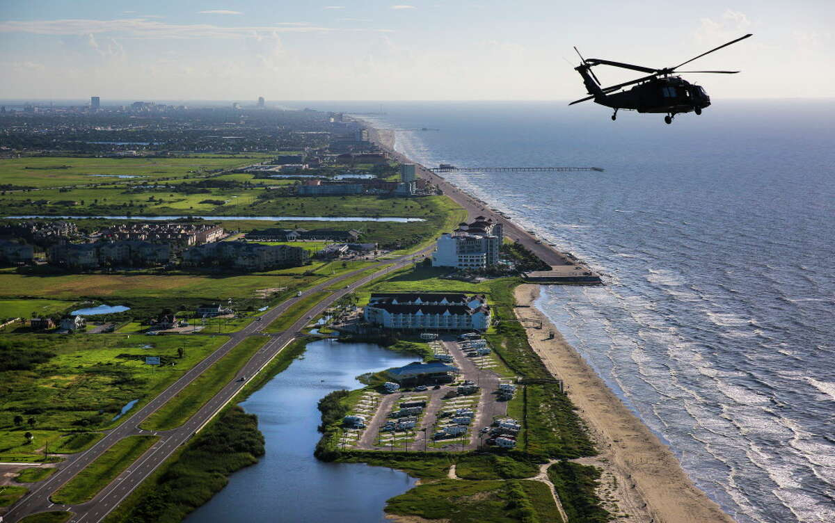 An Army Black Hawk helicopter, carrying U.S. Army Corps of Engineers officials, flies past the end of the seawall and over Galveston while looking at FEMA debris sites, temporary housing and rehabilitation considerations while on a tour of the Corps' current and proposed projects Wednesday, Sept. 7, 2016.