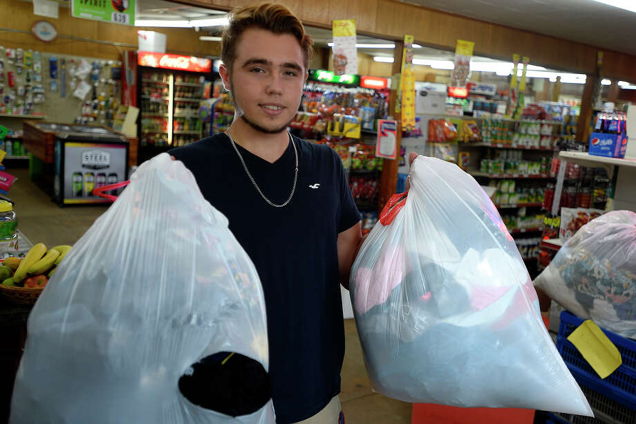 Jacob Scholl, 17, has collected three bags of clothing to help the homeless since posting a note at the China Market in China. Scholl became interested in helping after buying food for a man and his dog.  Photo taken Wednesday 9/7/16 Ryan Pelham/The Enterprise Photo: Ryan Pelham / ©2016 The Beaumont Enterprise/Ryan Pelham