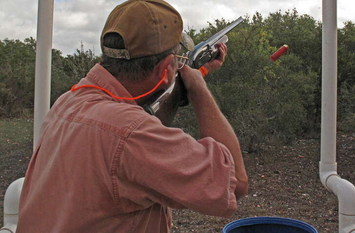 A participant in a previous Alamo Area OGT Clay Stoppers Shootout, which raises funds to help buy equipment for game wardens, shatters a sporting clay at the National Shooting Complex.
