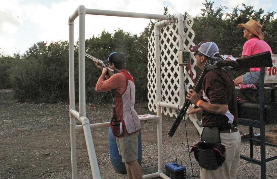 A shooter prepares to fire while another watches at the 2016 Alamo Area OGT Clay Stoppers Shootout, one of three across the state that have raised more than $1.5 million for Operation Game Thief, the states wildlife crime stoppers program. Photo: Express-News File Photo