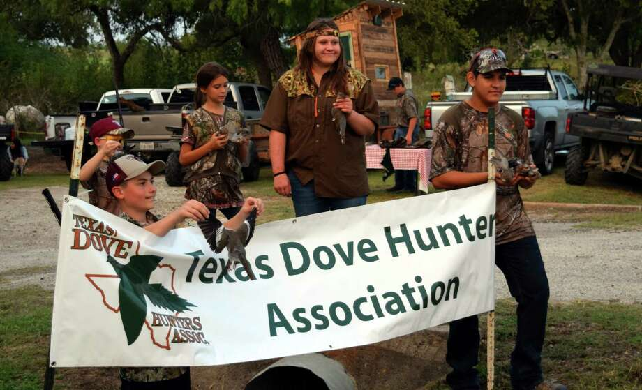 A happy collection of young dove hunters shows off their bagged birds following an afternoon youth mentor 2015 hunt in Karnes County organized by the Texas Dove Hunters Association. Photo: Ralph Winingham /For The Express-News