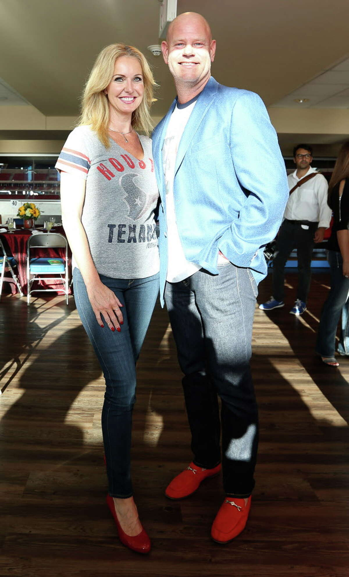 Angela Pollock and Brian Dubiski pose for a photo at the 4th Annual Fantasy Football Draft Night at NRG Stadium Wednesday, Sept. 7, 2016, in Houston. Funds raised at this event will benefit Boys & Girls Harbor.