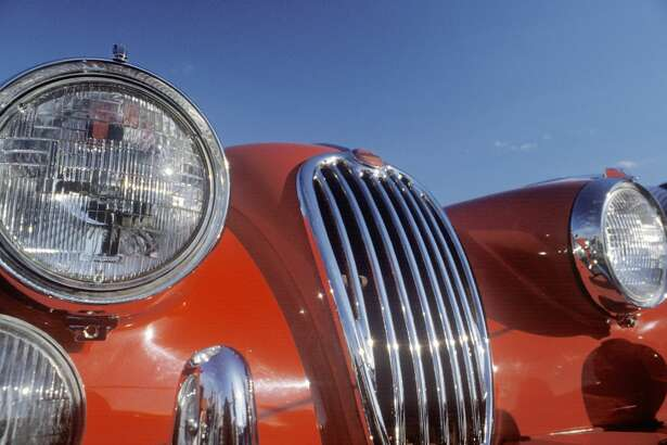 The front of a red Jaguar (Photo by Visions of America/UIG via Getty Images)