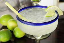 Mexico Jalisco Puerto Vallarta Frosted glass of a margarita cocktail served with ice and slice of lime with whole limes at side. (Photo by: Eye Ubiquitous/UIG via Getty Images)