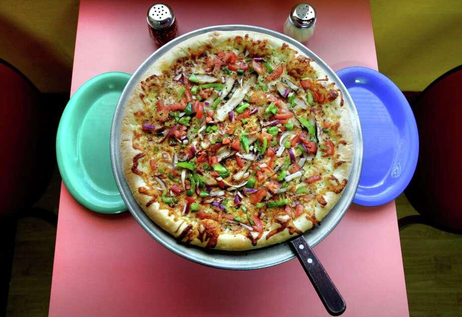 Alamo PizzaA chicken enchilada pizza? Only in San Antonio, at Alamo Pizza. Photo: Bob Owen /San Antonio Express-News / rowen@express-news.net