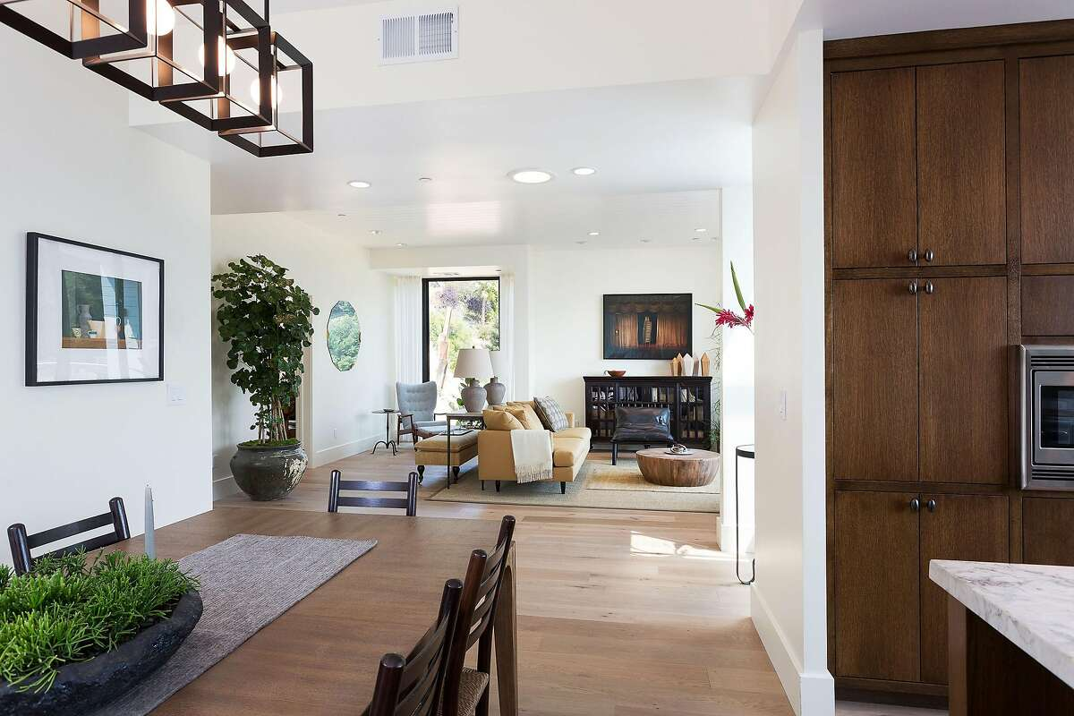 Wide-plank white oak flooring spans the interior of the newly built Craftsman.