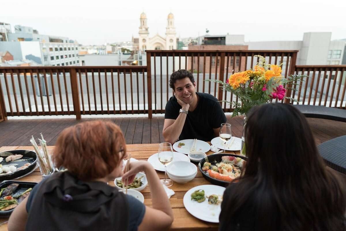 Reid Spitz, center, chats with others during a Common potluck in the Soma neighborhood in San Francisco, Calif. on Wednesday, Sept. 7, 2016. Common is a co-living startup from the same founders as General Assembly. Renters pay about $2,600 dollars which includes a private room, utilities and weekly potlucks.