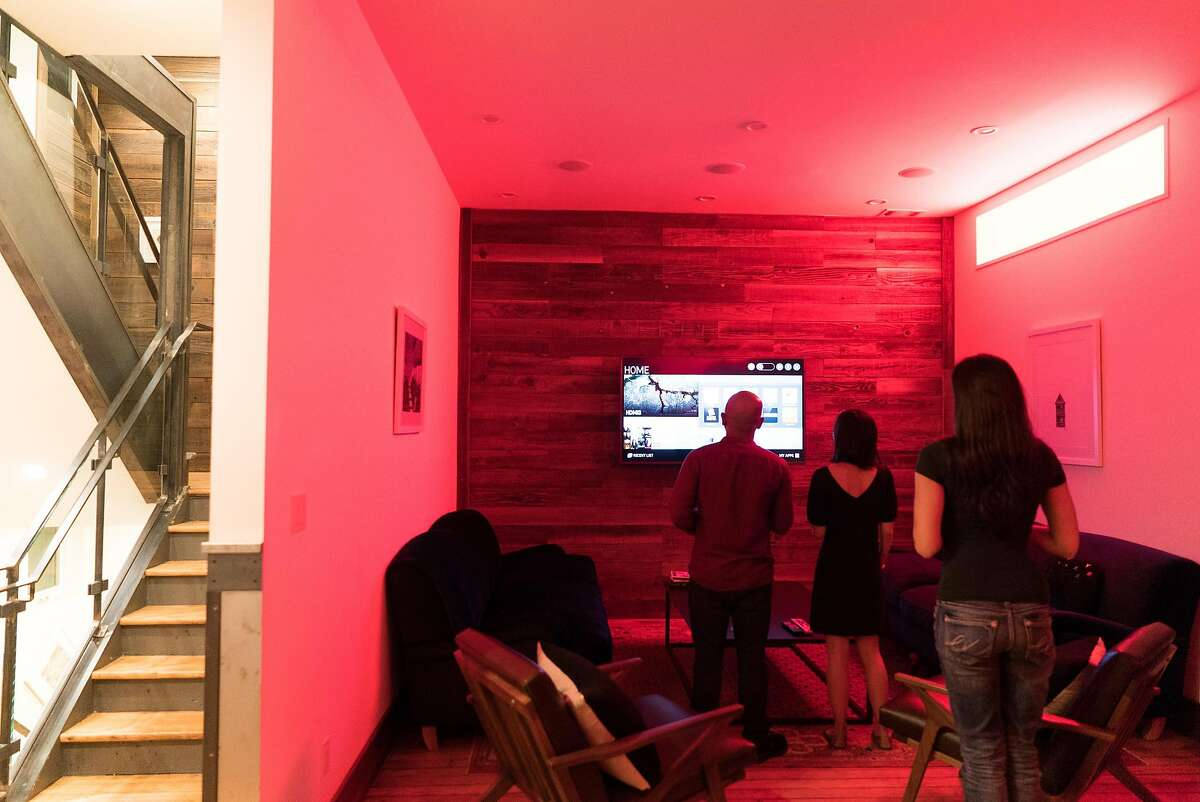 Members of Common search Netflix in one of the living rooms of their apartment in the Soma neighborhood in San Francisco, Calif. on Wednesday, Sept. 7, 2016. Common is a co-living startup from the same founders as General Assembly. Renters pay about $2,600 dollars which includes a private room, utilities and weekly potlucks.