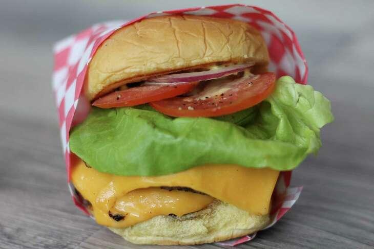 Chef Ryan Hildebrand of Triniti Restaurant & Sanctuari Bar will open FM burger in January. Shown: FM Double.