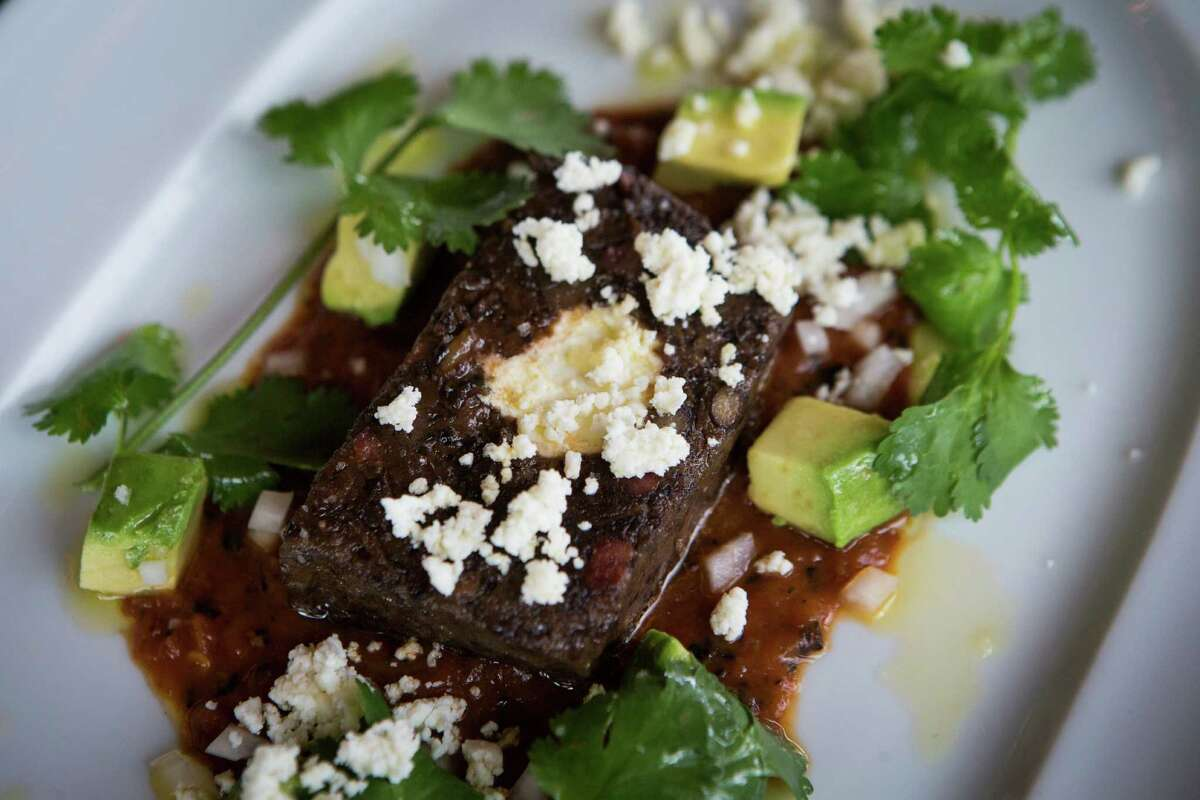 Black Bean Terrine with avocado and spicy roasted tomato salsa at Cafe Annie