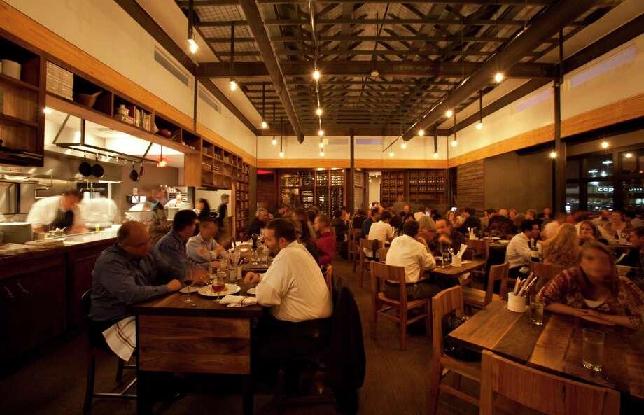 The bustling dining room at Underbelly. Photo: Julie Soefer