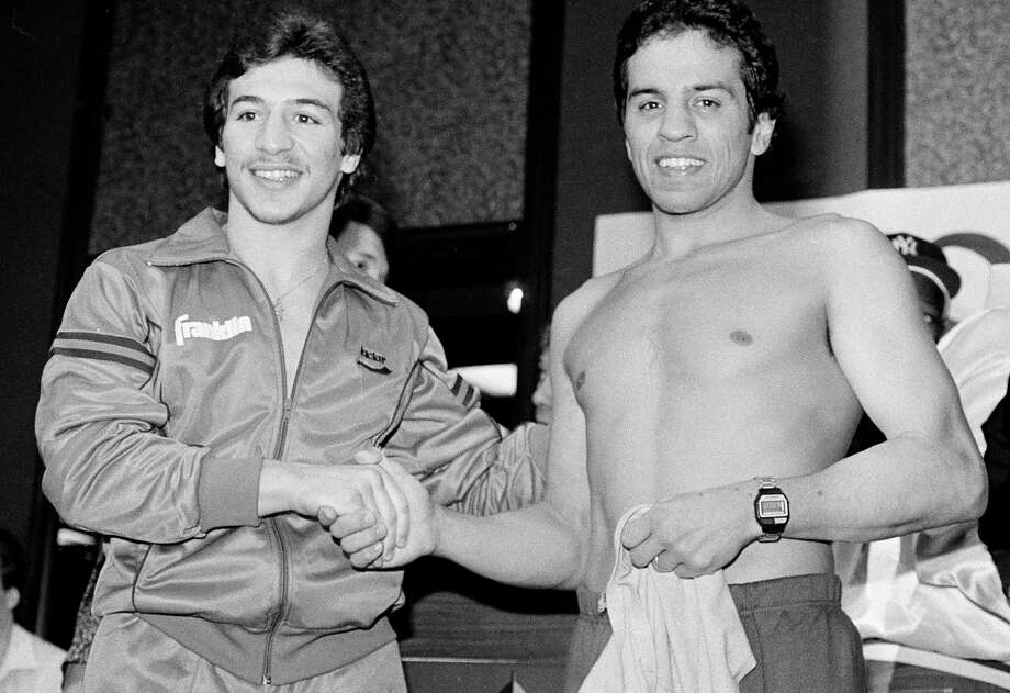 In this Jan 14, 1984, file photo, World Boxing Association lightweight champion Ray 'Boom Boom' Mancini (left) shakes hands with challenger Bobby Chacon during a fight weigh-in in Reno, Nevada. Chacon, a Hall of Fame boxer, died Sept. 7, 2016, under hospice care for dementia. He was 64. Photo: Walt Zeboski /Associated Press / AP1984