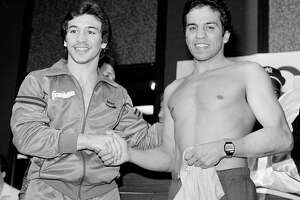 In this Jan 14, 1984, file photo, World Boxing Association lightweight champion Ray 'Boom Boom' Mancini (left) shakes hands with challenger Bobby Chacon during a fight weigh-in in Reno, Nevada. Chacon, a Hall of Fame boxer, died Sept. 7, 2016, under hospice care for dementia. He was 64.