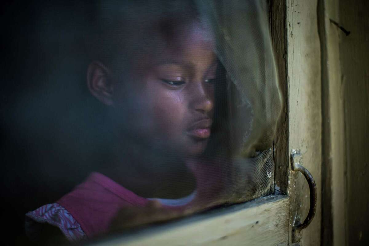 Tianny Jenkins reflects during a quiet moment at her family's tiny southeast Houston apartment. HISD ignored her mother's request for a special education evaluation, even as the 10-year-old was forced to repeat both second and third grades.